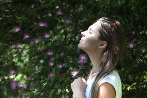 woman meditating law of attraction