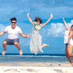 How to be happy - jumping for joy on beach