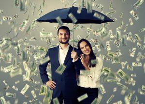sales techniques smiley successful couple with umbrella standing under money rain